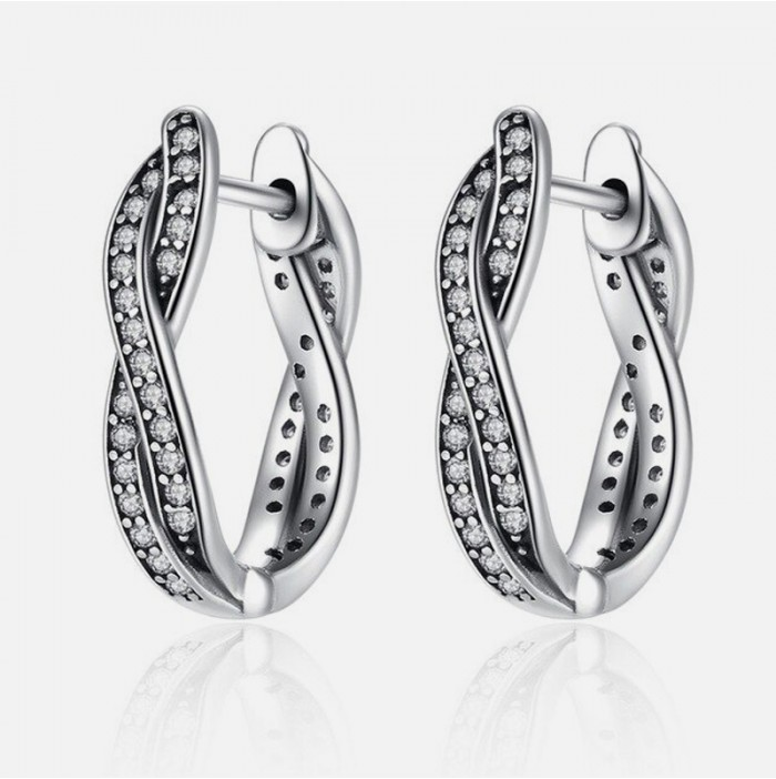 Twisted silver hoop earrings with zircons