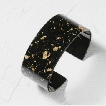 Black and gold resin cuff
