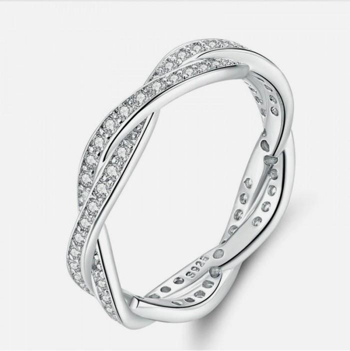 Twisted zircon ring